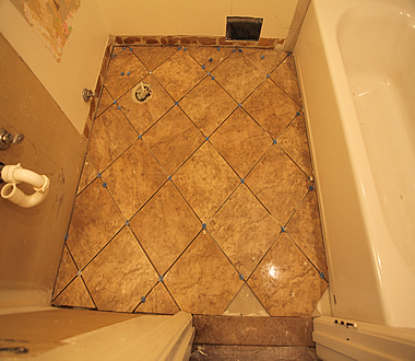 tile setter Evan Daniels, DIY diagonal bathroom tiling