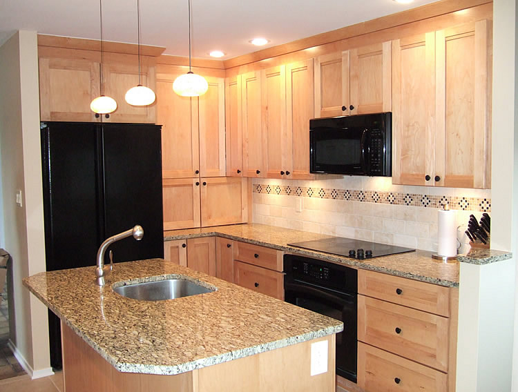 Photo of kitchen remodeling with natural maple cabinets, Saint Cecilia