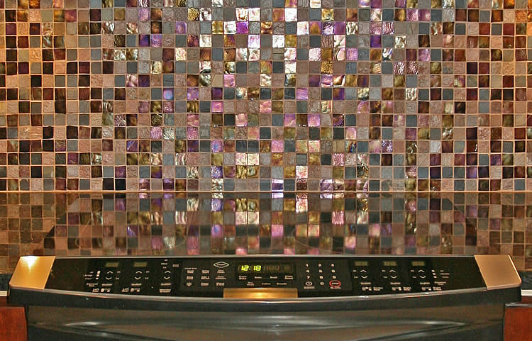 Oceanside glass mosaic tiles on kitchen countertop backsplash