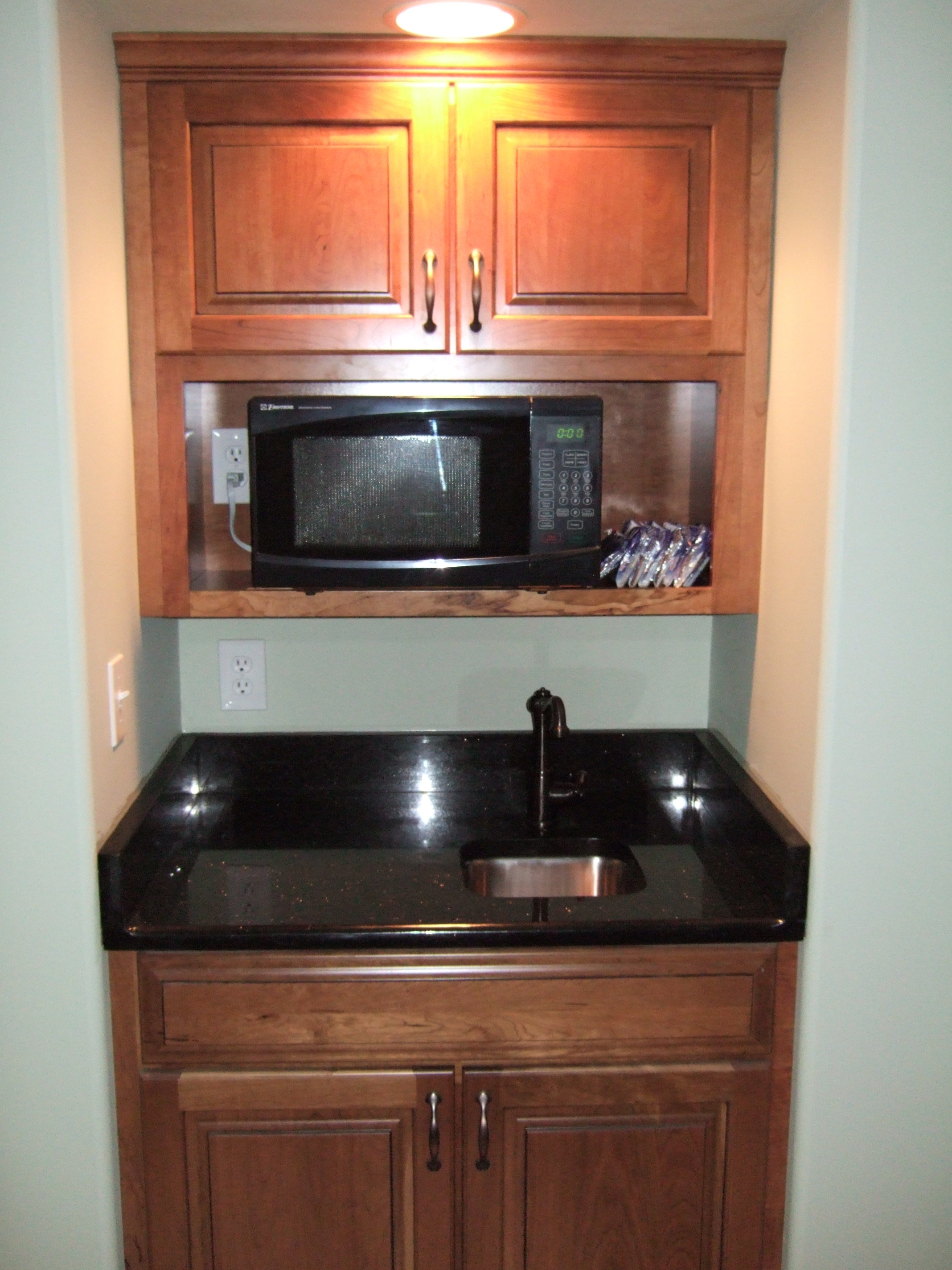 Granite counter undermount bar sink. Under counter frig and wine frig.
