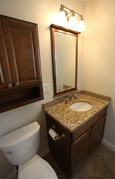 white bathroom vanity with black granite top