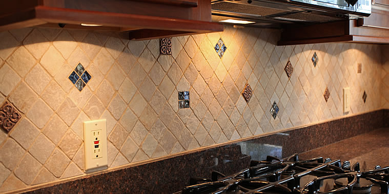 This picture of a kitchen tiled backsplash is done with 2x2 inch Key