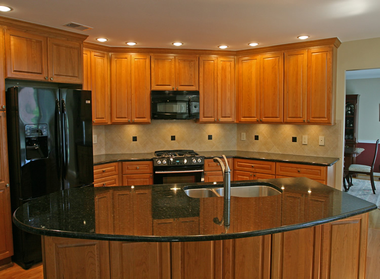 In this kitchen remodeling picture cabinets are Omega cherry