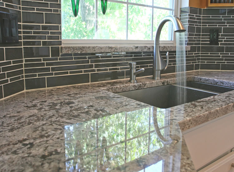 Backsplash is glass and looks much prettier