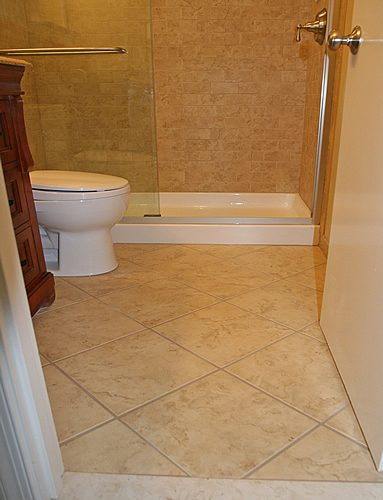 Bathroom designs small home design scrappy for Designer bathroom flooring