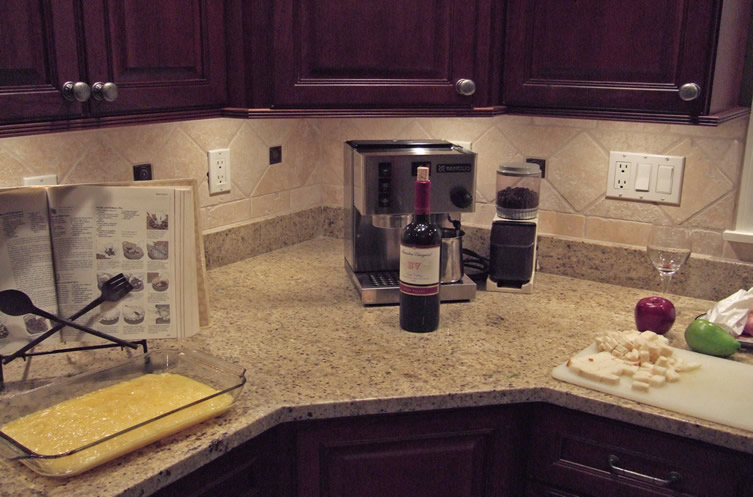 Black granite kitchen counter backsplash
