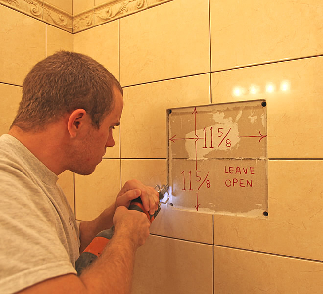 shower shampoo niche is installed after the tile is grouted and sealed